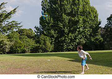 Boy Model Plane - Boy throws his model glider aircraft into...