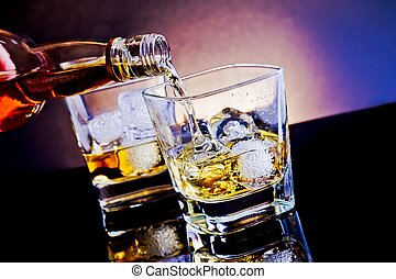 barman pouring whiskey in front of whiskey glass on light...
