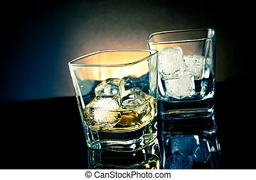whiskey glasses with ice and light tint blue disco on black...