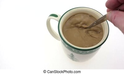 Quickly stirring coffee - Video of a mug of coffee with...