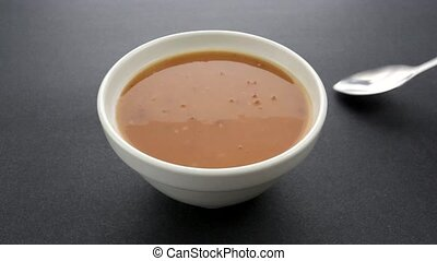 Bowl of tomato bisque soup - Video of a bowl of freshly made...