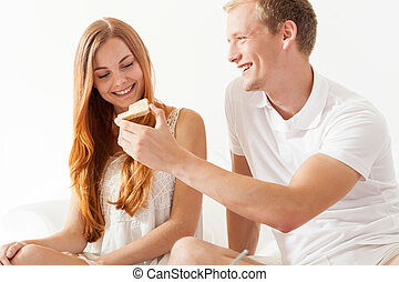 Woman and man sharing toast on breakfast