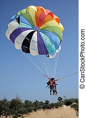 Parasail Landing - A view of an Indian couple landing from a...