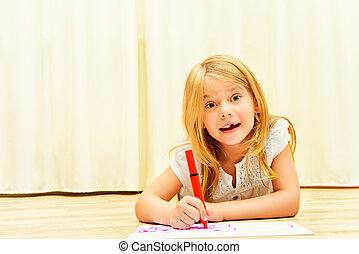 art in home - Cute girl on a floor and drawing on paper with...