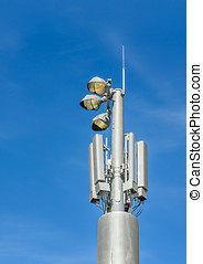 Outdoor stadium lights and telecommunication tower against...
