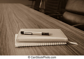 notebook on meeting table in conference room