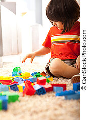 Toddler Boy Building With Blocks - A cute, bi-racial toddler...
