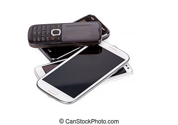 collection of cell phones, old design and new smart phones...