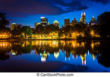 The Atlanta skyline reflecting in Lake Clara Meer in...