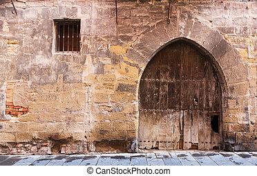 Vintage wooden double door in old arch