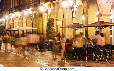 night street with restaurants in old european city
