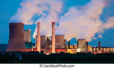 Power Station At Night - Time lapse sequence of one of the...