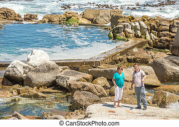 Sea Point Tidal Pool - Man and elderly woman standing by a...