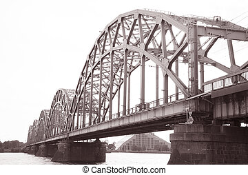 Railway Bridge and Banks of River Daugava, Riga, Latvia in...