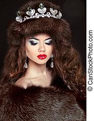Beautiful brunette woman in mink fur coat. Jewelry. Fashion...
