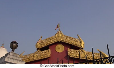 asian buddhists colorful flag on ornamental temple in...
