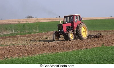 tractor cultivated farm field - small old agriculture...