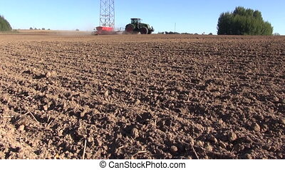 tractor seeding grains - agriculture tractor on autumn farm...