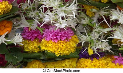 flowers garlands in asia market - various beautiful fresh...