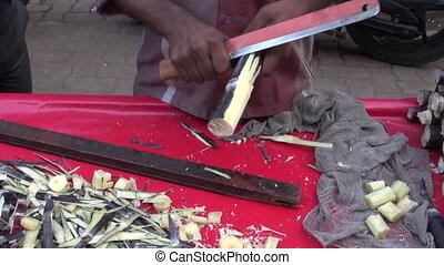 fresh sugarcane pieces in bazaar - fresh sugarcane pieces in...
