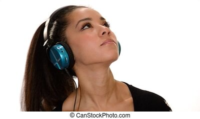 Girl listen to music and dance - young woman listening to...