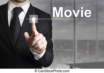 businessman pushing button movie - businessman in black suit...