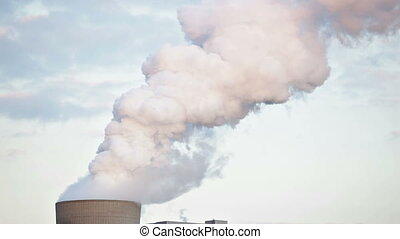 Steaming Cooling Tower - Cooling tower of a coal-fired power...