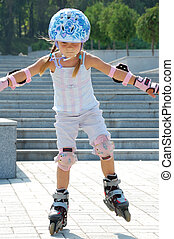 inline skating - little 5 year old girl rollerdlading in the...