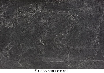 blank chalkboard with eraser smudges