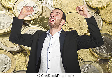 Man celebrates winning at lottery , with arms up