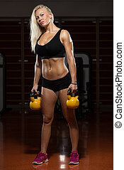 Woman And Kettle Bell - Fitness Woman Working Out With...