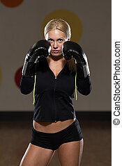 Woman Warrior - Young Woman Boxer MMA Fighter Practice Her...