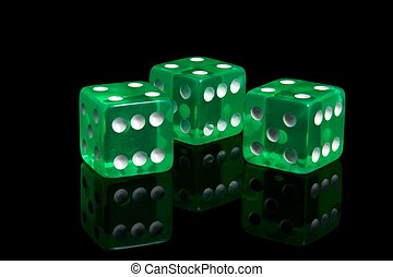 Casino dice - Three casino dice on a black background