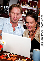 Attractive couple with laptop computer
