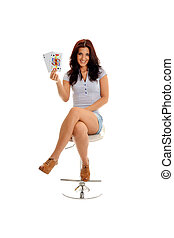 Black jack - Sexy brunette sitting on a stool happy with her...