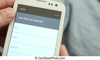 Service Survey on Mobile Phone - Anonymous man taking a...