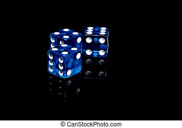 Casino dice - Three blue casino dice on a black background