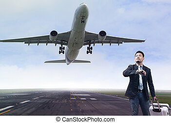 young business man standing in airport runways with...