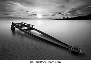 The boat trailer at Kon Ao Beach in black and white, Rayong,...