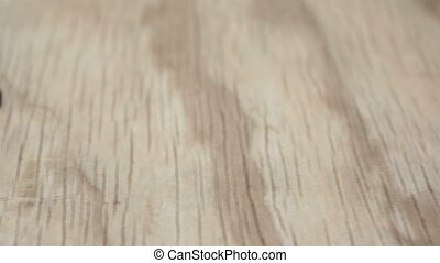 Juicy Raisins on Wood Background - Dolly shot of large and...