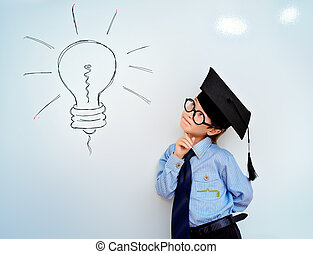 idea concept - Smart boy stands by the whiteboard in a...