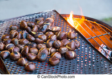 Grilling chestnuts. - Grilling chestnuts being sold at...