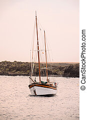 Vintage Sail Boat Wooden Vesessel in the Ocean
