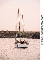 Vintage Sail Boat Wooden Vesessel in the Ocean