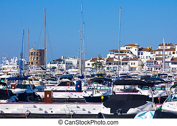 sports boats and yachts with the city of Puerto Banus in the bac