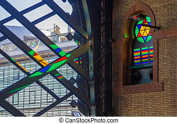 Details of the windows of the old train station in Seville, Spai