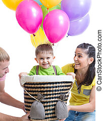 family play at birthday party and playing with son in flight on a makeshift balloon