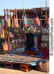 Flea Market Shop - A streetside shop selling different types...