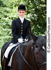 Horseback riding - A caucasian teenage girl riding a horse...