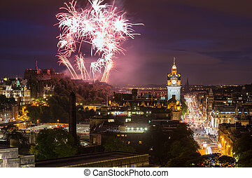 Edinburgh Cityscape with fireworks over The Castle and Balmoral Clock Tower